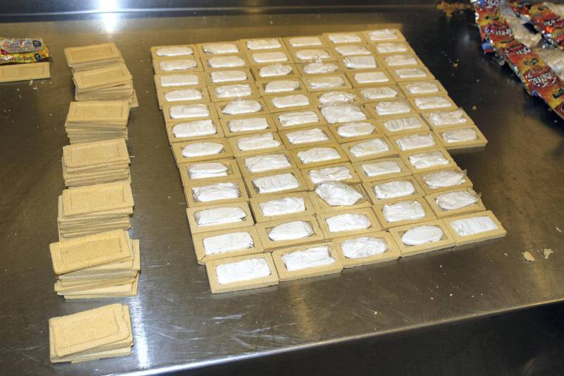 This April 2015 photo provided by U.S. Customs and Border Protection shows vanilla wafers filled with cocaine in Houston. A Guatemalan citizen arrived at George Bush Intercontinental Airport from Guatemala City in April with packages of vanilla wafers. But when customs officials opened them up, they said they found they were filled with cocaine instead of cream filling. He also had bags of chips that had small bundles of cocaine inside of them. The 4 pounds of cocaine had a street value of more than $60,000. (U.S. Customs and Border Protection via AP)