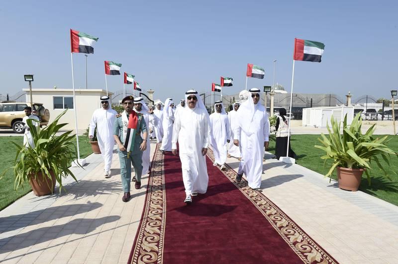 UMM AL QAIWAIN, 2nd November, 2017 (WAM) -- H.H. Sheikh Saud bin Rashid Al Mu'alla, Supreme Council Member and Ruler of Umm Al Qaiwain, on Thursday raised the national flag at Al Khor Park in Umm Al Qaiwain on the occasion of Flag Day, which coincides with the 12th anniversary of President His Highness Sheikh Khalifa bin Zayed Al Nahyan's accession to the Presidency of the UAE. He was accompanied by H.H. Sheikh Rashid bin Saud bin Rashid Al Mu'alla, Crown Prince of Umm Al Qaiwain. WAM