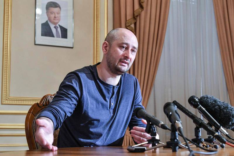 TOPSHOT - Anti-Kremlin journalist Arkady Babchenko addresses a press conference on May 31, 2018 in Kiev during which he dismissed criticism of cooperating with Ukrainian security services in the staging of his death, a day following his shock reappearance after Ukrainian authorities said he had been shot dead.  In an operation that blindsided the world's media, Babchenko made a shock reappearance at a press conference in Kiev on May 31, less than 24 hours after the Ukrainian authorities reported he had been shot dead at his home in a contract-style killing blamed on Russia. / AFP / GENYA SAVILOV