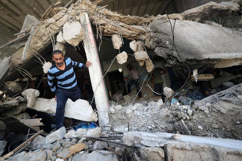 A Palestinian man walks through the ruins in the aftermath of Israeli air strikes, in Gaza City May 17, 2021. REUTERS/Mohammed Salem