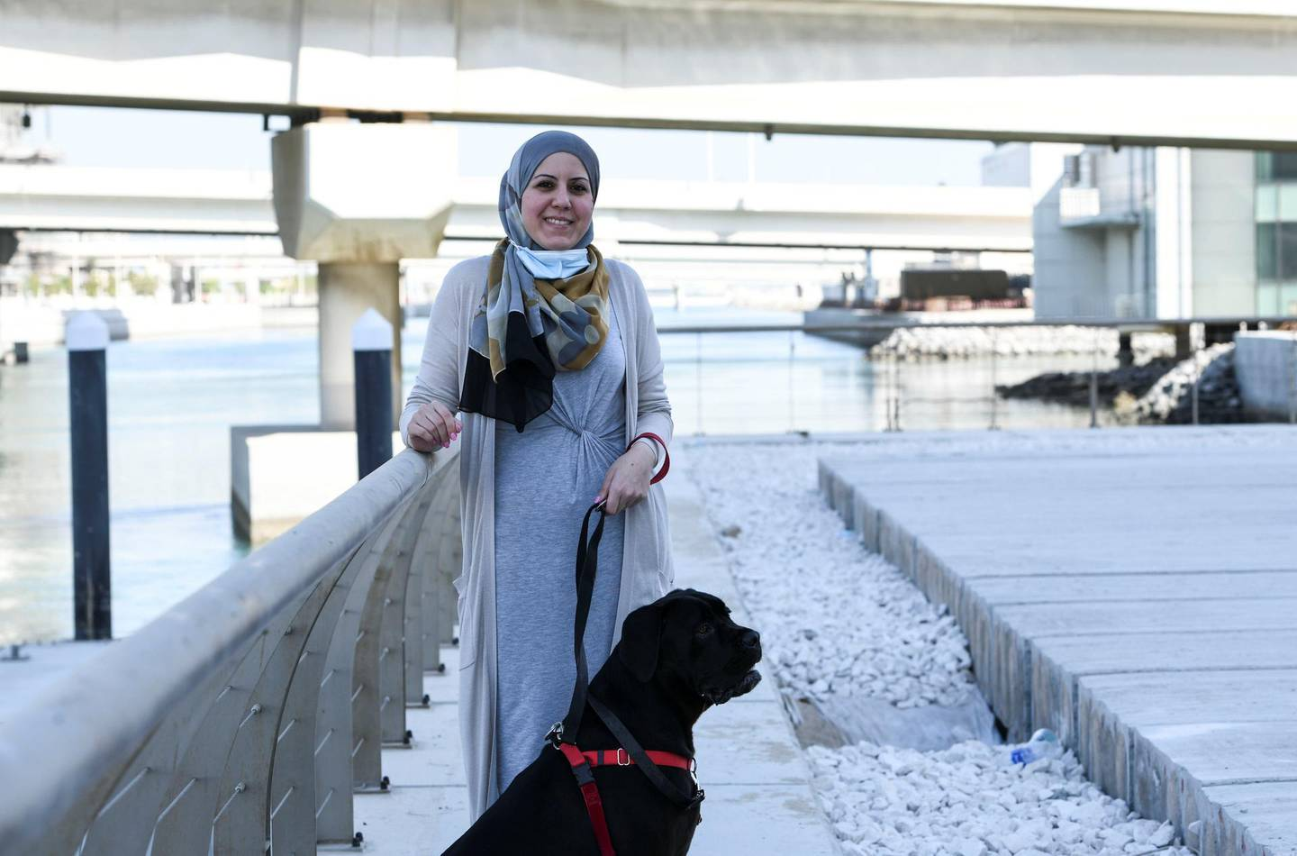 Abu Dhabi, United Arab Emirates - Yasmeen El Mallah outside her residence  with her dog Pablo, who is 4 years old, and was adopted from Egypt.  She enjoys living on Al Reem Island, and has been residing there for the past 6 years. Khushnum Bhandari for The National