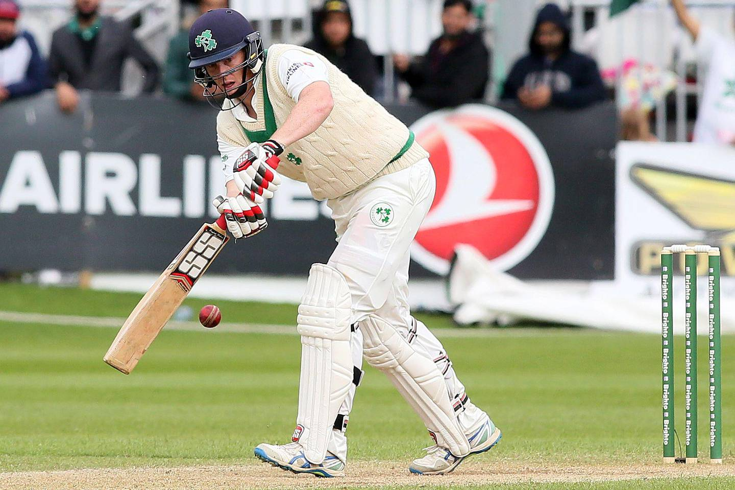 Ireland's Kevin O'Brien plays a shot on day four of Ireland's inaugural test match against Pakistan at Malahide cricket club, in Dublin on May 14, 2018.  / AFP / Paul FAITH