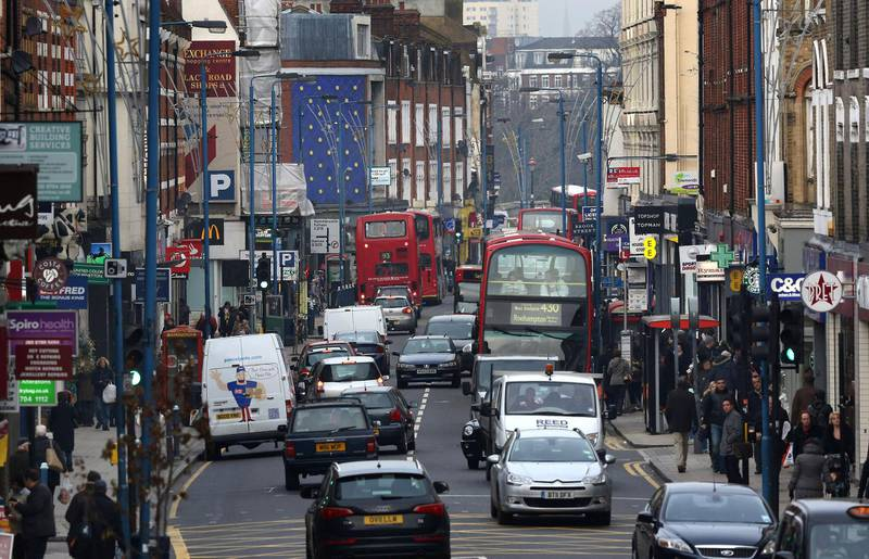 PUTNEY, ENGLAND - JANUARY 10:  Traffic fills Putney High Street on January 10, 2013 in Putney, England. Local media are reporting environmental campaigners claims that levels of traffic pollutants, mostly nitrogen dioxide, have breached upper safe limits in the busy street in south west London.  (Photo by Peter Macdiarmid/Getty Images)