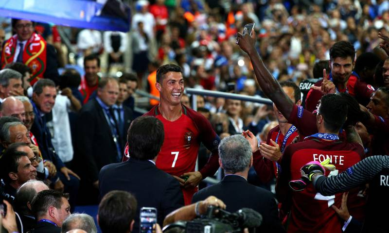 PARIS, FRANCE - JULY 10:  Cristiano Ronaldo of Portugal celebrates during the award ceremony after his team's 1-0 win in the UEFA EURO 2016 Final match between Portugal and France at Stade de France on July 10, 2016 in Paris, France.  (Photo by Alex Livesey/Getty Images)