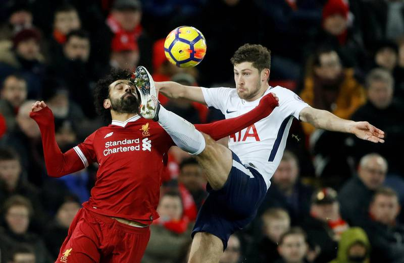 """Soccer Football - Premier League - Liverpool vs Tottenham Hotspur - Anfield, Liverpool, Britain - February 4, 2018   Tottenham's Ben Davies in action with Liverpool's Mohamed Salah    Action Images via Reuters/Carl Recine    EDITORIAL USE ONLY. No use with unauthorized audio, video, data, fixture lists, club/league logos or """"live"""" services. Online in-match use limited to 75 images, no video emulation. No use in betting, games or single club/league/player publications.  Please contact your account representative for further details.     TPX IMAGES OF THE DAY"""