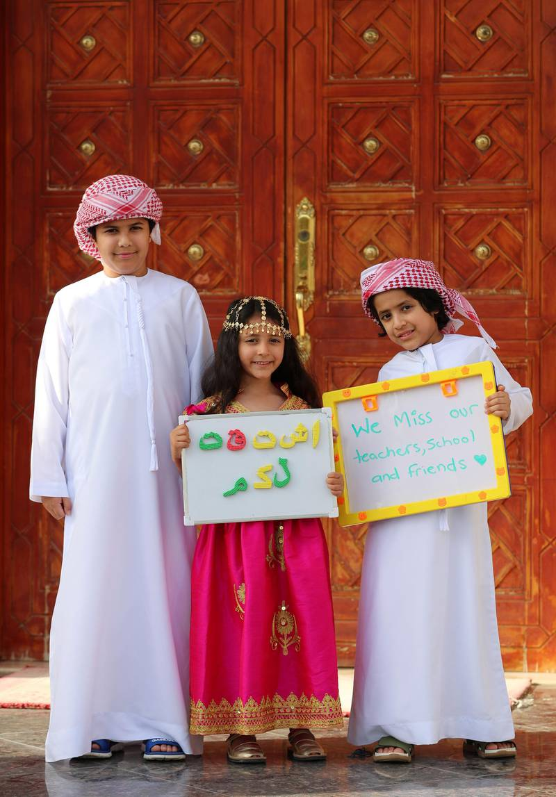 """Dubai, United Arab Emirates - Reporter: N/A. Photo Project. Missing our teachers. L-R Bader, Aisha and Zeyad, aged 8, 5 and 7 from the UAE and their teachers are Mr. Ben, Ms Basemah, Ms Katy, Ms Hanadi, Ms. Riz and Ms Seera at GEMS national school for boys and Gems national school for girls. """"Thanks so much"""". Monday, June 8th, 2020. Dubai. Chris Whiteoak / The National"""