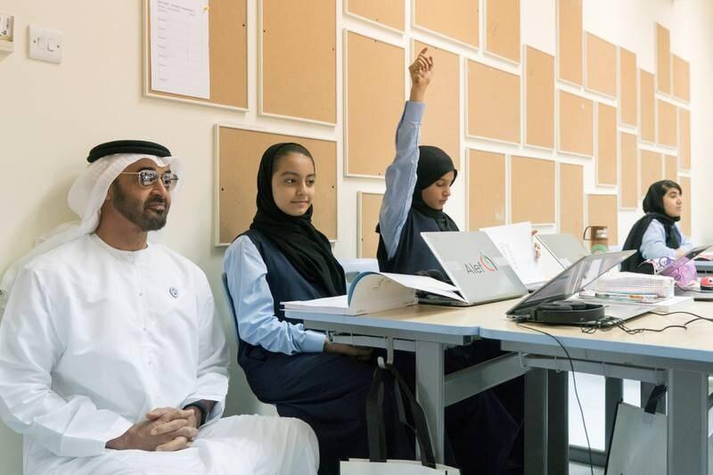 ABU DHABI, UNITED ARAB EMIRATES - September 02, 2018: HH Sheikh Mohamed bin Zayed Al Nahyan, Crown Prince of Abu Dhabi and Deputy Supreme Commander of the UAE Armed Forces (L), visits Al Asayel Primary School.  ( Rashed Al Mansoori / Crown Prince Court - Abu Dhabi ) ---
