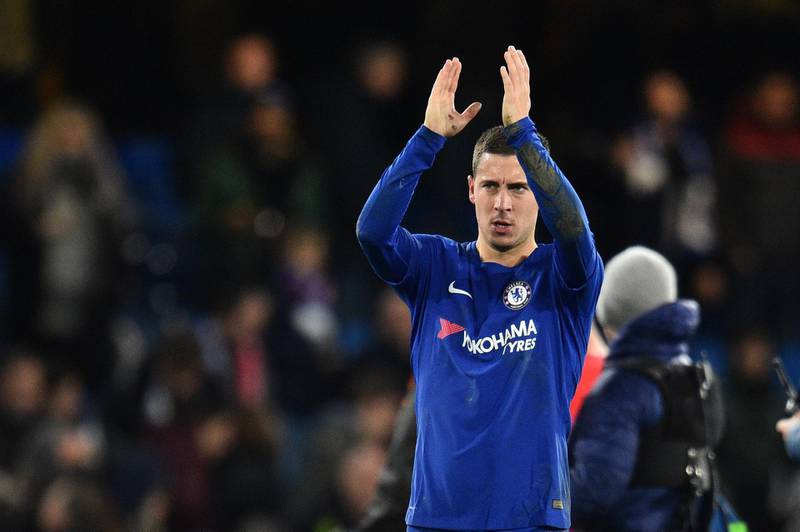 Chelsea's Belgian midfielder Eden Hazard applauds the crowd after a UEFA Champions League Group C football match between Chelsea and Atletico Madrid at Stamford Bridge in London on December 5, 2017. / AFP PHOTO / Glyn KIRK