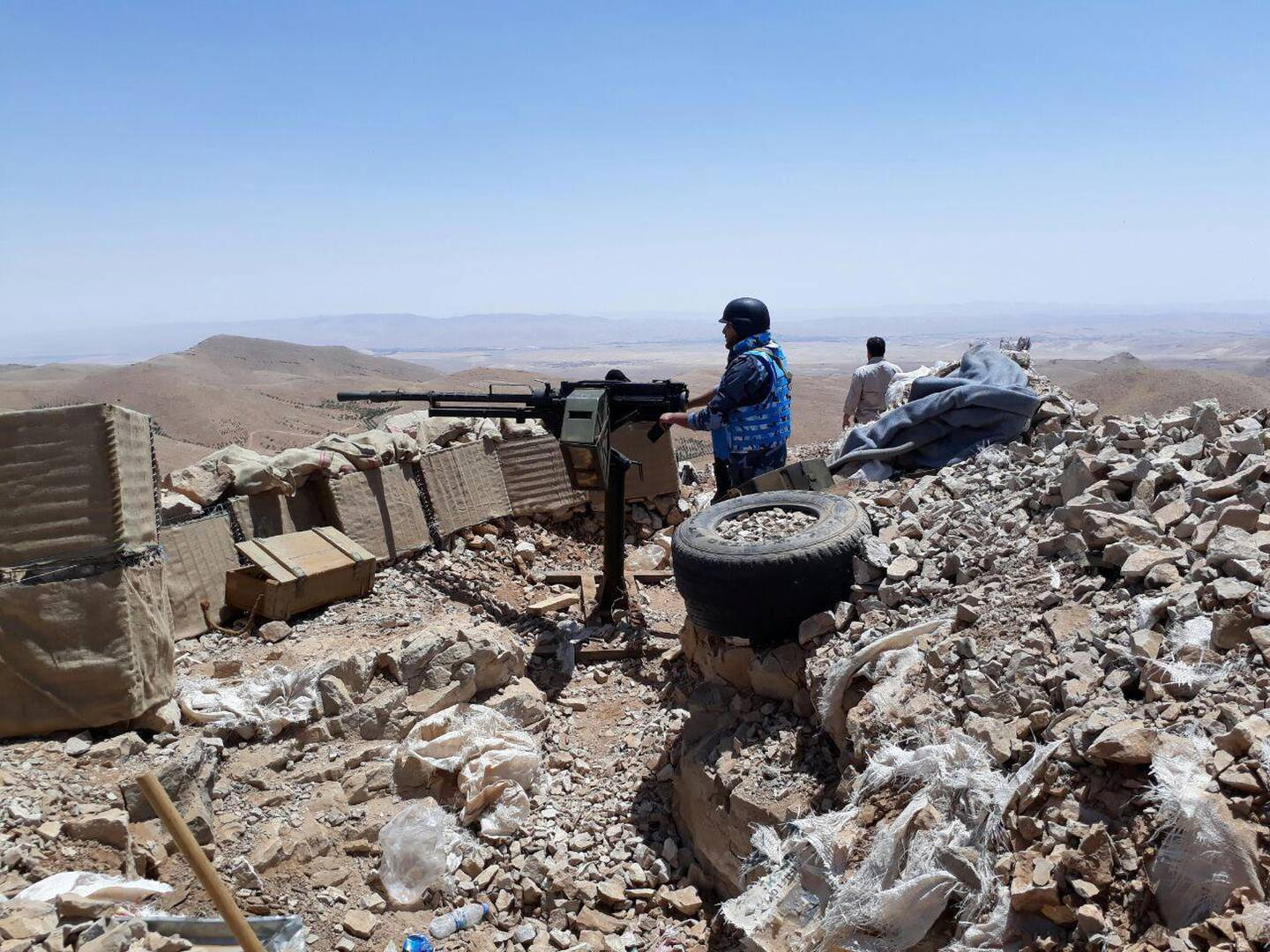 Fighters from the Syrian army units and Hezbollah are seen on the western mountains of Qalamoun, near Damascus, in this handout picture provided by SANA on July 23, 2017, Syria. SANA/Handout via REUTERS  ATTENTION EDITORS - THIS PICTURE WAS PROVIDED BY A THIRD PARTY. REUTERS IS UNABLE TO INDEPENDENTLY VERIFY THE AUTHENTICITY, CONTENT, LOCATION OR DATE OF THIS IMAGE.