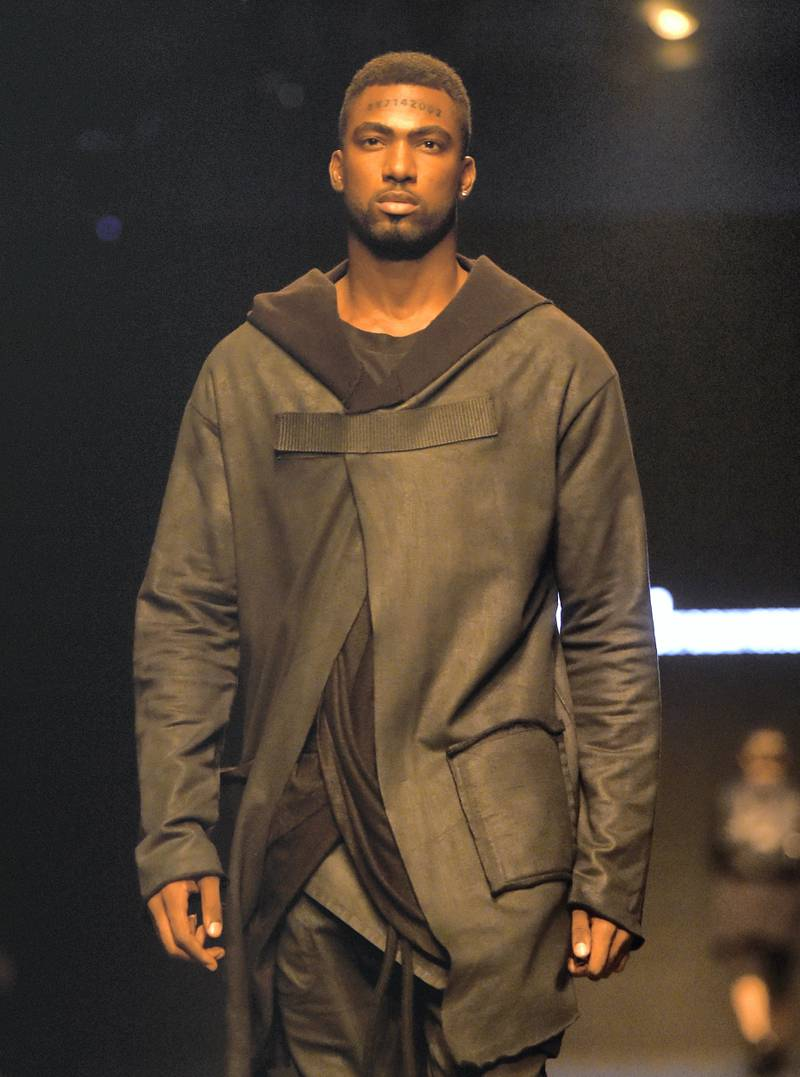 A model walks the runway during the Uniti by Babak Vosoughi Menswear show at Fashion Forward October 2017 held at the Dubai Design District on October 27, 2017 in Dubai, United Arab Emirates.