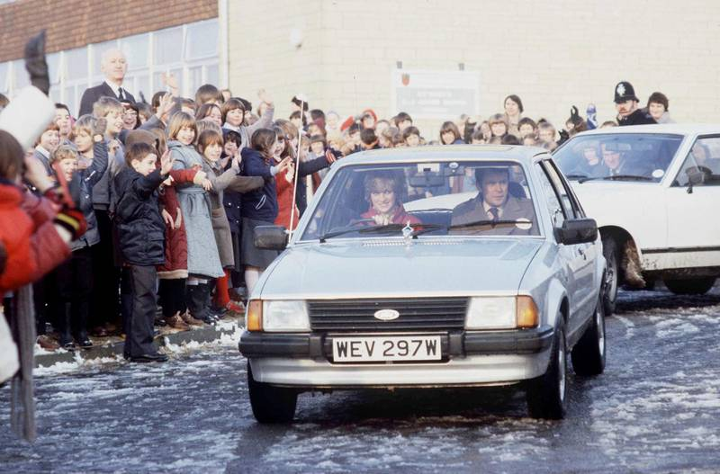 TETBURY, UNITED KINGDOM - DECEMBER 08:  Princess Diana Driving Her Ford Escort Car On  A Visit To St Mary's School In  Tetbury. In The Passenger Seat Is Her Police Bodyguard Graham Smith  (Photo by Tim Graham Photo Library via Getty Images)