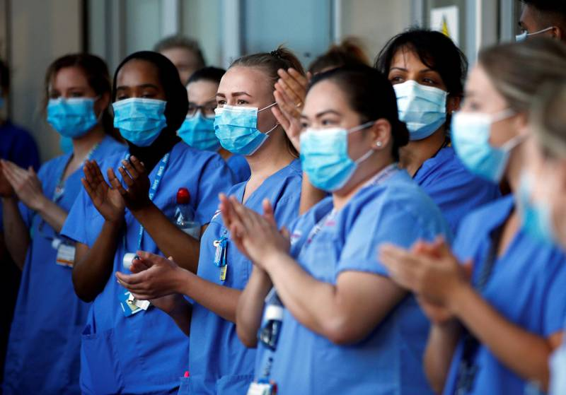 NHS workers react at the Royal London Hospital during the last day of the Clap for our Carers campaign in support of the NHS, following the outbreak of the coronavirus disease (COVID-19), London, Britain, May 28, 2020. REUTERS/Henry Nicholls     TPX IMAGES OF THE DAY
