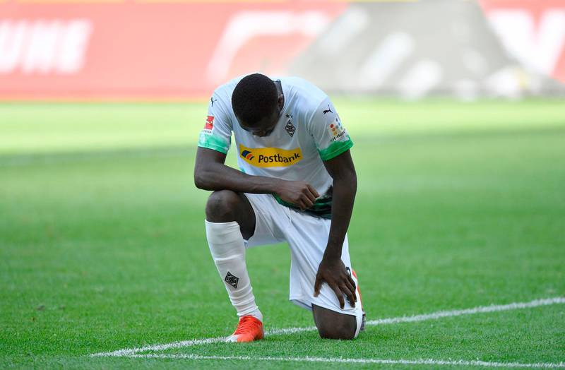 Moenchengladbach's French forward Marcus Thuram reacts after scoring during the German first division Bundesliga football match Borussia Moenchengladbach v Union Berlin in Moenchengladbach, western Germany, on 31 May, 2020. RESTRICTIONS: DFL REGULATIONS PROHIBIT ANY USE OF PHOTOGRAPHS AS IMAGE SEQUENCES AND/OR QUASI-VIDEO   / AFP / POOL / Martin Meissner / RESTRICTIONS: DFL REGULATIONS PROHIBIT ANY USE OF PHOTOGRAPHS AS IMAGE SEQUENCES AND/OR QUASI-VIDEO