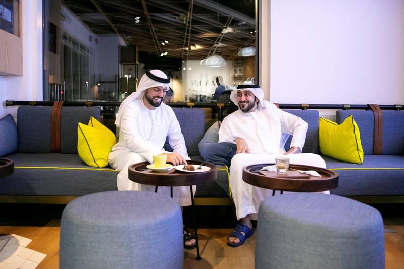 ABU DHABI, UNITED ARAB EMIRATES - JUNE 10, 2018. Jassim Al Ali, left, and Tarek Al Sayqal at Rain cafe.(Photo by Reem Mohammed/The National)Reporter: John DennehySection: NA