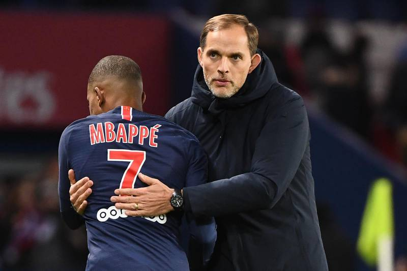 (FILES) This file photo taken on January 27, 2019 at the end of the French L1 football match between Paris Saint-Germain (PSG) and Stade Rennais FC at the Parc des Princes stadium in Paris shows Paris Saint-Germain's French forward Kylian Mbappe (L)congratulated by German coach Thomas Tuchel who has been sacked as PSG's head coach on December 24, 2020. The French champions declined to make any comment when contacted by AFP to confirm the reports carried by L'Equipe newspaper and RMC and German tabloid Bild.  / AFP / FRANCK FIFE