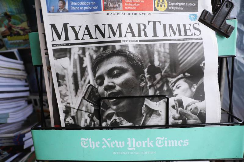 A Myanmar newspaper displays the story about the sentences received by Reuters journalists Wa Lone and Kyaw Soe Oo, on its front page in Yangon, Myanmar, September 4, 2018. REUTERS/Ann Wang        NO RESALES. NO ARCHIVES.