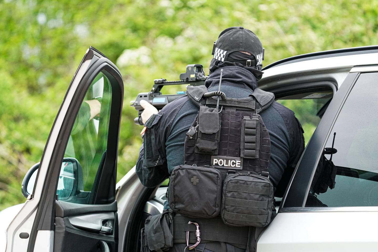 EXETER, ENGLAND - MAY 21: Police officers demonstrate armed stop and arrest techniques on a driver during a demonstration organised by Devon And Cornwall Police to illustrate the skills they may have to draw upon on order to police the forthcoming G7 Summit in Cornwall, on May 21, 2021 in Exeter, England. A wide variety of specially trained police officers will be ready to support their colleagues depending on the activities of protesters, activists and others who may seek to cause public disruption during the event. (Photo by Hugh Hastings/Getty Images)