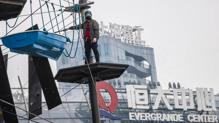 An image that illustrates this article Evergrande shares rise as developer resumes work on stalled projects