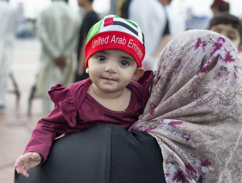 Abu Dhabi, United Arab Emirates - A baby with UAE cap on to celebrate the UAE National Day at Abu Dhabi Corniche, Breakwater.  Leslie Pableo for The National