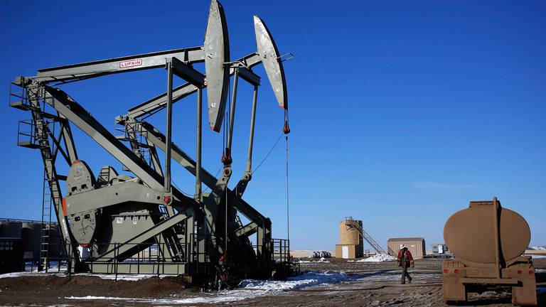 An image that illustrates this article Oil tops $80 per barrel to reach three-year high