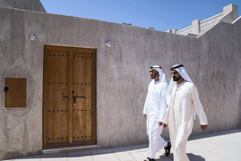 DUBAI, UNITED ARAB EMIRATES - March 20, 2018: HH Sheikh Mohamed bin Zayed Al Nahyan Crown Prince of Abu Dhabi Deputy Supreme Commander of the UAE Armed Forces (L) and HH Sheikh Mohamed bin Rashid Al Maktoum, Vice-President, Prime Minister of the  UAE, Ruler of Dubai and Minister of Defence (R), walk in Shindagha Heritage District before the signing of a joint venture agreement between Aldar and Emaar.   ( Mohamed Al Hammadi / Crown Prince Court - Abu Dhabi ) ---