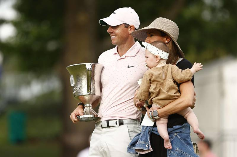 CHARLOTTE, NORTH CAROLINA - MAY 09: Rory McIlroy of Northern Ireland celebrates with the trophy alongside his wife Erica and daughter Poppy after winning during the final round of the 2021 Wells Fargo Championship at Quail Hollow Club on May 09, 2021 in Charlotte, North Carolina.   Maddie Meyer/Getty Images/AFP == FOR NEWSPAPERS, INTERNET, TELCOS & TELEVISION USE ONLY ==