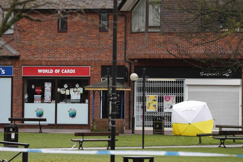 A police cordon remains at The Maltings shopping centre in Salisbury, southern England, on March 12, 2018, where a man and woman were found critically ill on March 4, after being apparently poisoned with what was later identified as a nerve agent sparking a major incident. British Prime Minister Theresa May will chair a meeting of her national security team Monday after weekend confirmation that traces of a nerve agent used in the attempted murder of former Russian spy Sergei Skripal, and his daughter Yulia, were found in a pub and a restaurant they visited. / AFP PHOTO / Adrian DENNIS