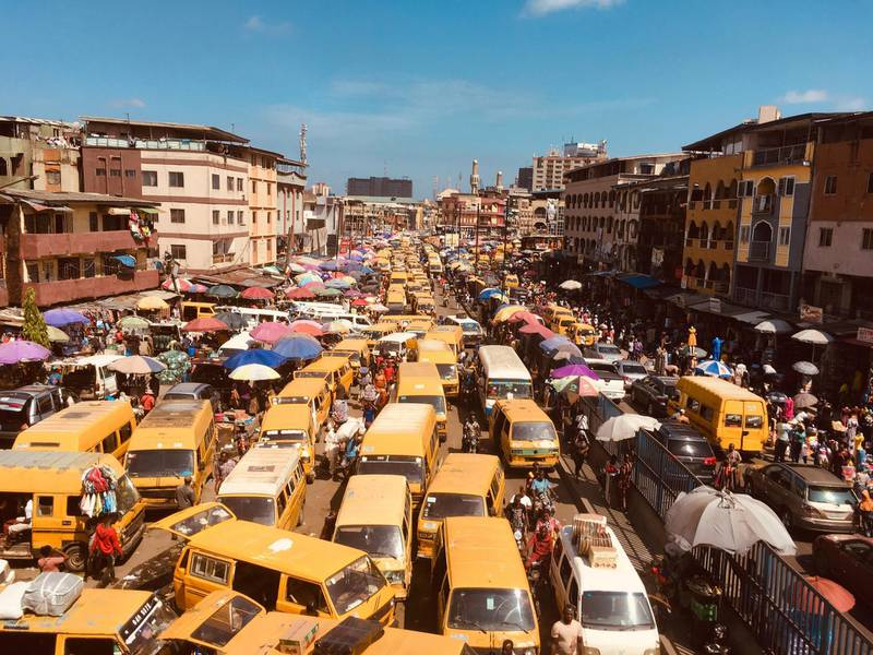 Pedestrian shop inside a market in Lagos, Nigeria, Monday June 7, 2021. Nigeria's government announced on Friday that it was suspending Twitter indefinitely in Africa's most populous nation, a day after the company deleted a controversial tweet President Muhammadu Buhari made about a secessionist movement. (AP Photo/Sunday Alamba)