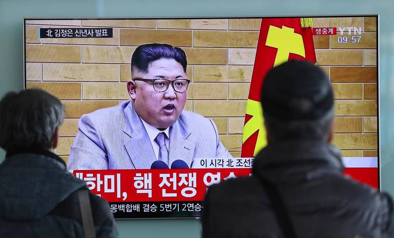 """South Koreans watch a TV news program showing North Korean leader Kim Jong Un's New Year's address, at the Seoul Railway Station in Seoul, South Korea, Monday, Jan. 1, 2018. The part of letters on the bottom """"South Korea and U.S., Nuclear War exercise."""" and on top left, """"Kim Jong Un delivers New Year's address.""""  North Korean leader Kim Jong Un said Monday, Jan. 1, 2018,  the United States should be aware that his country's nuclear forces are now a reality, not a threat. But he also struck a conciliatory tone in his New Year's address, wishing success for the Winter Olympics set to begin in the South in February and suggesting the North may send a delegation to participate.(AP Photo/Lee Jin-man)"""