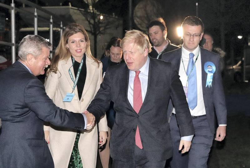 LONDON, ENGLAND - DECEMBER 13: Prime Minister Boris Johnson and his partner Carrie Symonds attend the vote count for his Uxbridge and South Ruislip constituency on December 13, 2019 in Uxbridge, England. Exit polls predicted the Prime Minister, who has held the Uxbridge and South Ruislip seat since 2015, will emerge from this general election with a governing majority, his aim when he called the first UK winter election for nearly a century. Election results from across the country are being counted overnight and an overall result is expected in the early hours of Friday morning. (Photo by Dan Kitwood/Getty Images)