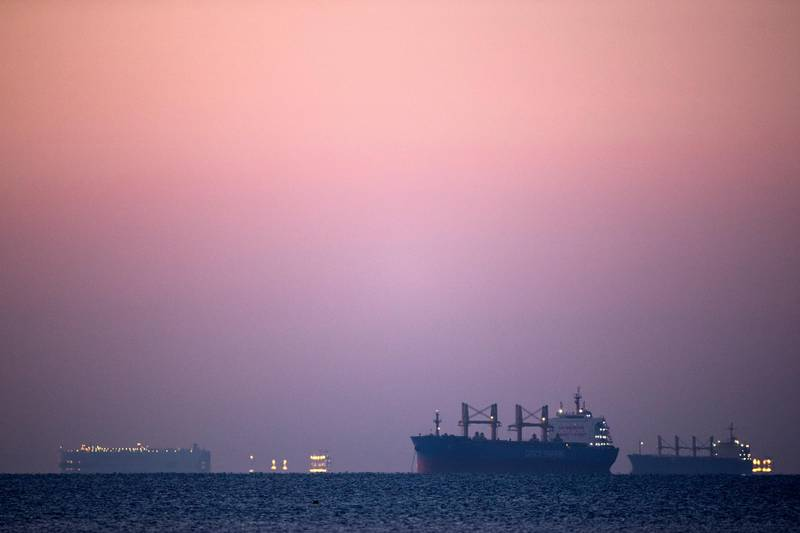 SUEZ, EGYPT - MARCH 29: Ships and boats are seen at the entrance of Suez Canal on March 29, 2021 in Suez, Egypt. Work continues to free the Ever Given, a huge container ship stuck sideways in Egypt's Suez Canal. The ship ran aground in the canal on March 23, after being caught in 40-knot winds. Dredgers have been working on the port side of the ship in an attempt to remove sand and mud and dislodge the vessel. The Suez Canal is one of the worlds busiest shipping lanes and the blockage has created a backlog of vessels at either end, raising concerns over the impact the accident will have on global shipping and supply chains. (Photo by Mahmoud Khaled/Getty Images)