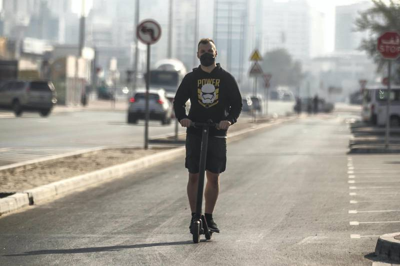 SHARJAH, UNITED ARAB EMIRATES. 01 MARCH 2021. A man rides an electric scooter down a one way road in the Al Quoz district of Dubai. (Photo: Antonie Robertson/The National) Journalist: None. Section: National.