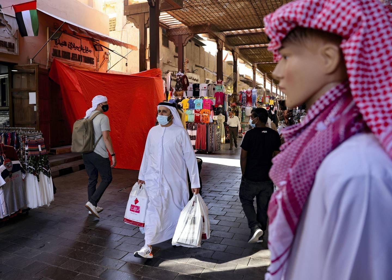 Emiratis shop at the Dubai grand market, in the Gulf city of Dubai, on January 6, 2021. (Photo by Karim SAHIB / AFP)