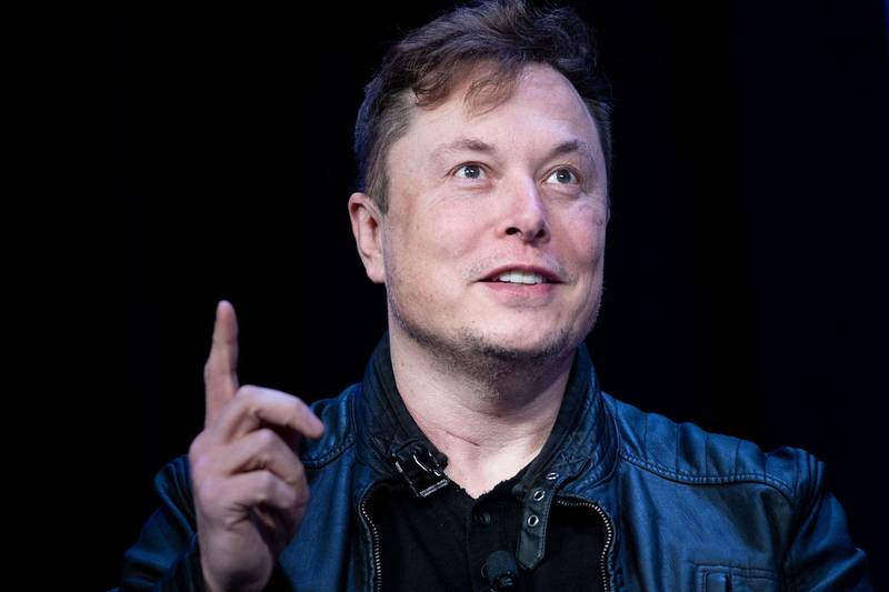 """(FILES) In this file photo Elon Musk, founder of SpaceX, speaks during the Satellite 2020 at the Washington Convention Center on March 9, 2020, in Washington, DC. Tesla began officially accepting bitcoin as currency to purchase electric autos, Chief Executive Elon Musk said on March 24, 2021 a with bitcoin,"""" Musk said on Twitter, implementing a plan announced in February to accept the cryptocurrency as a form of payment.   / AFP / Brendan Smialowski"""