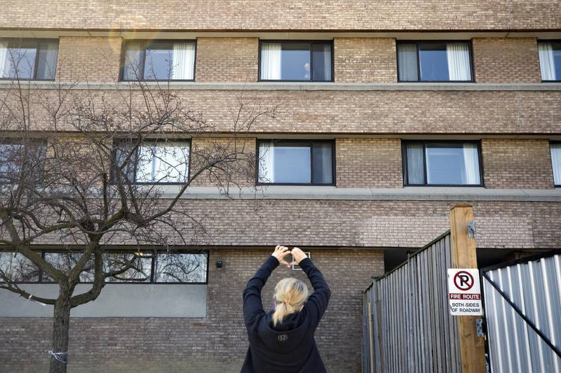 A relative gestures to a resident in a window at the Eatonville Care Centre, a long-term care home, in Toronto, Ontario, Canada, on Saturday, April 25, 2020. Canada's two largest provinces have called for military assistance to fight Covid-19 outbreaks they have been unable to get under control in long-term care facilities. Photographer: Cole Burston/Bloomberg