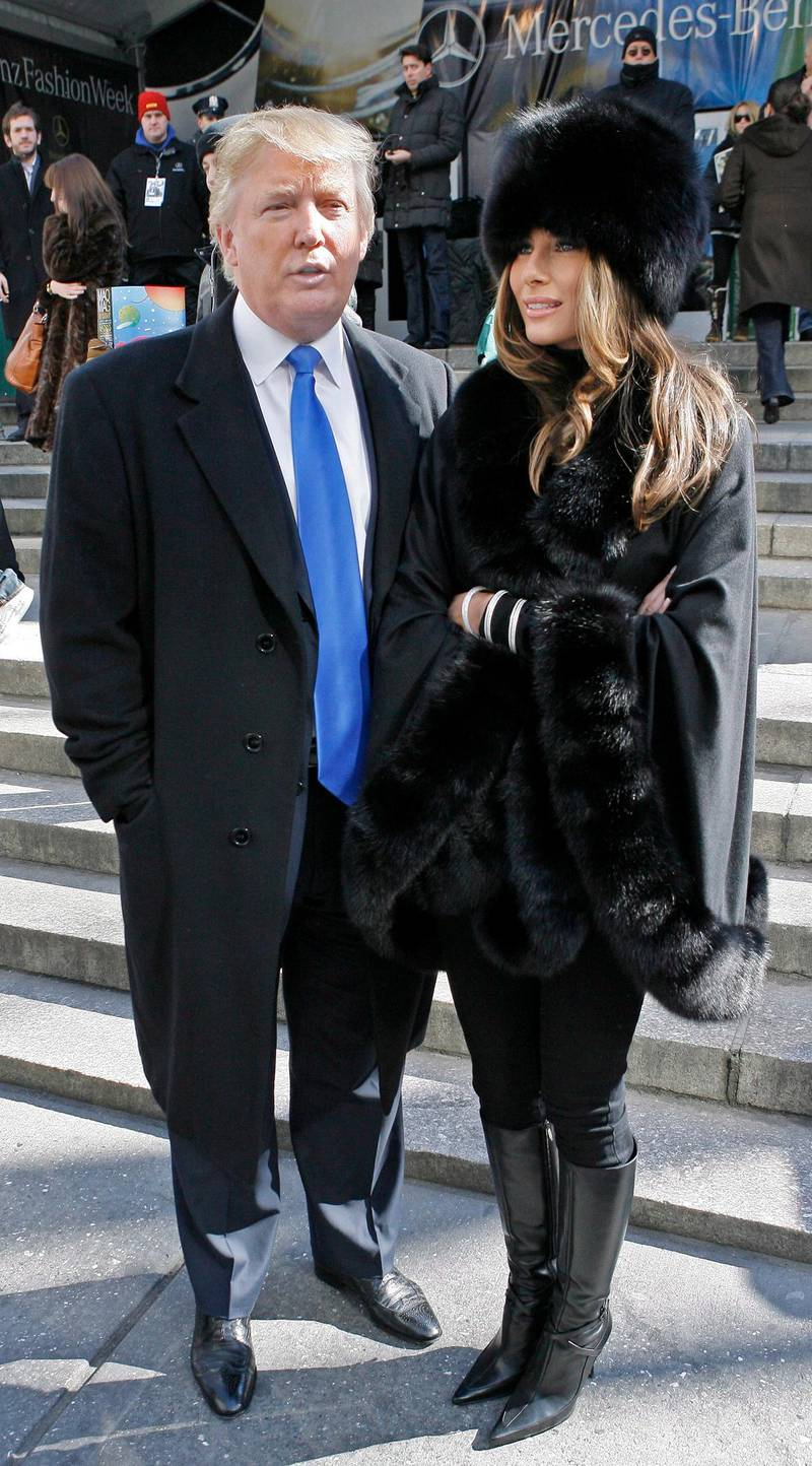 epa00925351 Donald and Melania Trump exit the Michael Kors Fashion Show at Mercedes- Benz Fashion Week in New York City, Wednesday February 07, 2007.  EPA/PETER FOLEY