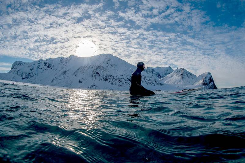 Surf instructor Tommy Olsen monitors his group of surf beginners during their 1st course at snowy beach of Unstad, in Lofoten Island, Arctic Circle, on March 09, 2016. - Surfers from all over the world comes to Lofoten island to surf in extrem conditions. Ocean temperature is 6-7 °C, air temperature around 0°C in spite of a weather very unstable. (Photo by OLIVIER MORIN / AFP)
