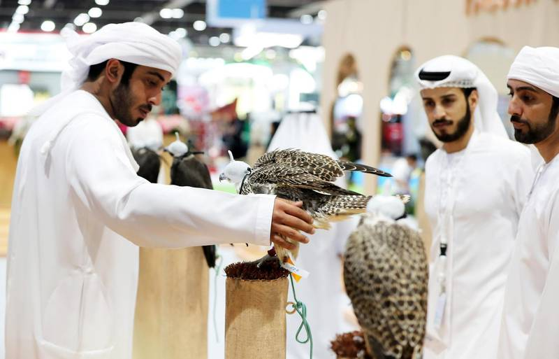 ABU DHABI ,  UNITED ARAB EMIRATES , AUGUST 27 – 2019 :- Visitors looking the Falcon at the Falcon Center during the ADIHEX 2019 held at ADNEC in Abu Dhabi. ( Pawan Singh / The National ) For News/Online/Instagram/Big Picture. Story by Daniel