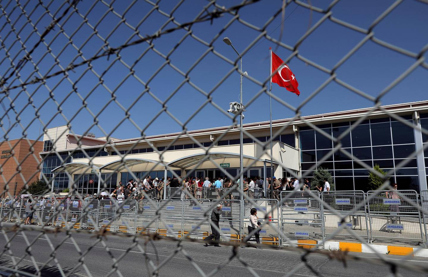 FILE PHOTO: Friends and supporters of the defendants line up to enter the courtroom at the Silivri Prison and Courthouse complex in Silivri near Istanbul, Turkey, June 24, 2019. REUTERS/Huseyin Aldemir/File Photo
