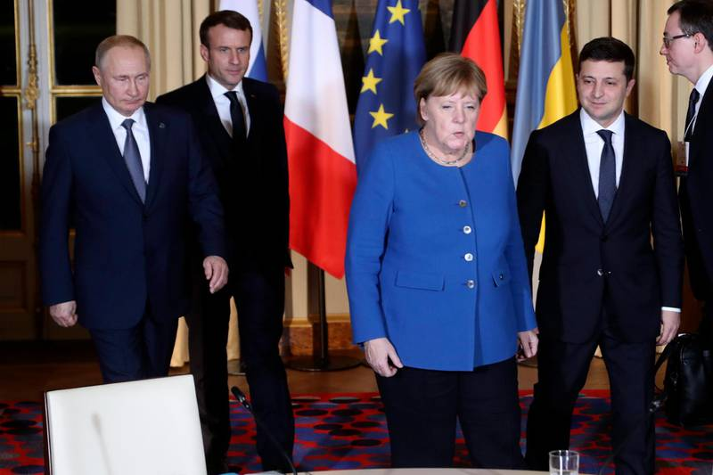 epa08057611 (L-R) Russian President Vladimir Putin, French President Emmanuel Macron, German Chancellor Angela Merkelm, and Ukrainian President Volodymyr Zelenskiy arrive for a working session at the Elysee Palace in Paris, France, 09 December 2019. German Chancellor Merkel, French President Macron, Ukrainian President Zelensky and Russian President Putin took part in the summit. The Normandy format was created in 2014 to resolve the conflict between Kiev and the breakaway republics in Ukraine's east.  EPA/Thibault Camus / POOL  MAXPPP OUT