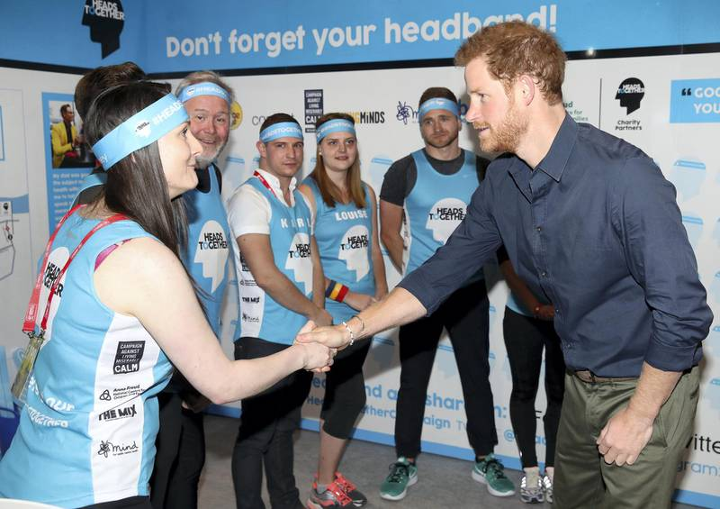 """LONDON, ENGLAND - APRIL 19:  Prince Harry meets runners as he officially opens the Virgin Money London Marathon Expo at ExCel on April 19, 2017 in London, England. Prince Harry, who is Patron of the London Marathon Charitable Trust, will hand out race numbers, along with special edition """"Heads Together"""" headbands, which is the official Charity of the Year for this yearÂ's marathon.  (Photo by Chris Jackson - WPA Pool/Getty Images)"""