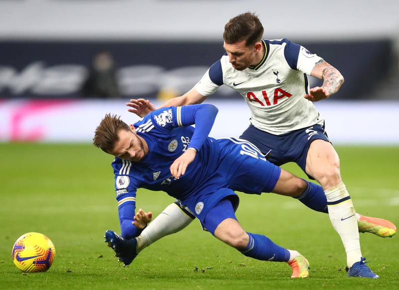 LONDON, ENGLAND - DECEMBER 20: Pierre-Emile Hojbjerg of Tottenham Hotspur tackles James Maddison of Leicester City  during the Premier League match between Tottenham Hotspur and Leicester City at Tottenham Hotspur Stadium on December 20, 2020 in London, England. The match will be played without fans, behind closed doors as a Covid-19 precaution. (Photo by Julian Finney/Getty Images)