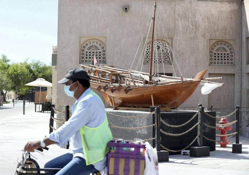 Dubai, United Arab Emirates - Reporter: N/A. News. Coronavirus/Covid-19. A man on a bike rides passed a model of a dow in Bur Dubai. Saturday, October 17th, 2020. Dubai. Chris Whiteoak / The National