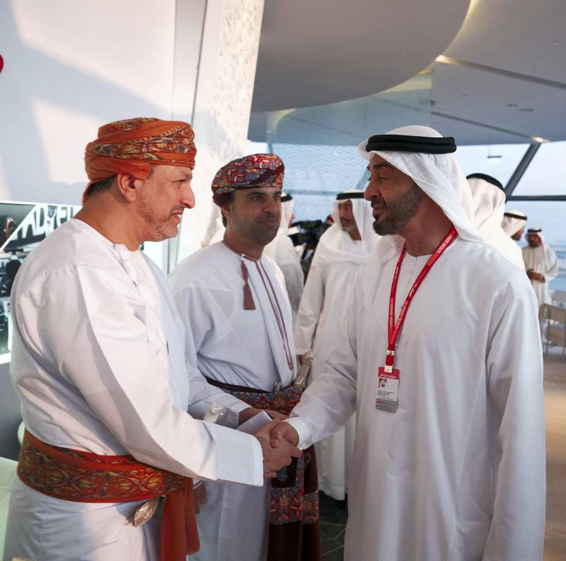 YAS ISLAND, ABU DHABI, UNITED ARAB EMIRATES - December 01, 2019: HH Sheikh Mohamed bin Zayed Al Nahyan, Crown Prince of Abu Dhabi and Deputy Supreme Commander of the UAE Armed Forces (R), greets a guest at Shams Tower during the Formula 1 2019 Etihad Airways Abu Dhabi Grand Prix at Yas Marina Circuit.   ( Hamad Al Kaabi  / Ministry of Presidential Affairs ) ---