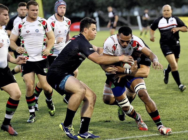 Dubai, April 13, 2018: Dubai Exiles (Black ) vs Abu Dhabi Harlequins (White)  in action during the UAE Premiership finals match at the Rugby Park in Dubai. Satish Kumar for the National / Story by Paul Radley