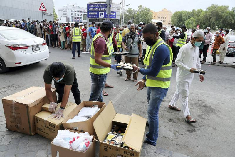 DUBAI, UNITED ARAB EMIRATES , April 28 – 2020 :- 300 packets of cooked food provided by Guru Nanak Darbar (Sikh Temple in Jebel Ali) for the needy and distributed by the Markaz volunteers before the Iftar time during the Ramadan at the Naif area in Deira Dubai. (Pawan Singh / The National) For News/Standalone/Online