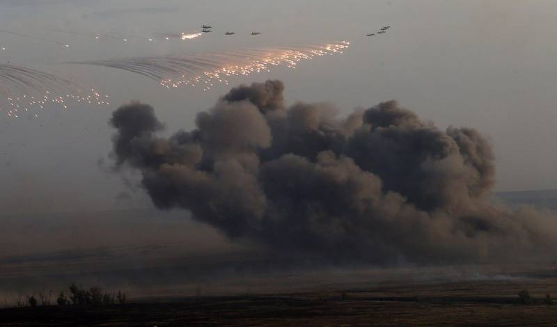 ORENBURG, RUSSIA- SEPTEMBER 19: Planes drop bombs during Russias large-scale Center-2015 military exercises at Donguzsky Range September 19, 2015 in Orenburg, Russia, The exercises, aim to contain the outbreak of an armed conflict in Central Asia. Putin said this week that it's impossible to defeat Islamic State group without support of the government of Syria and that Moscow has provided military assistance to President Bashar al-Assad's regime and will continue to do so. (Photo by Sasha Mordovets/Getty Images)
