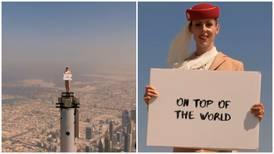 Emirates 'flight attendant' stands on Burj Khalifa to celebrate UK travel rules change
