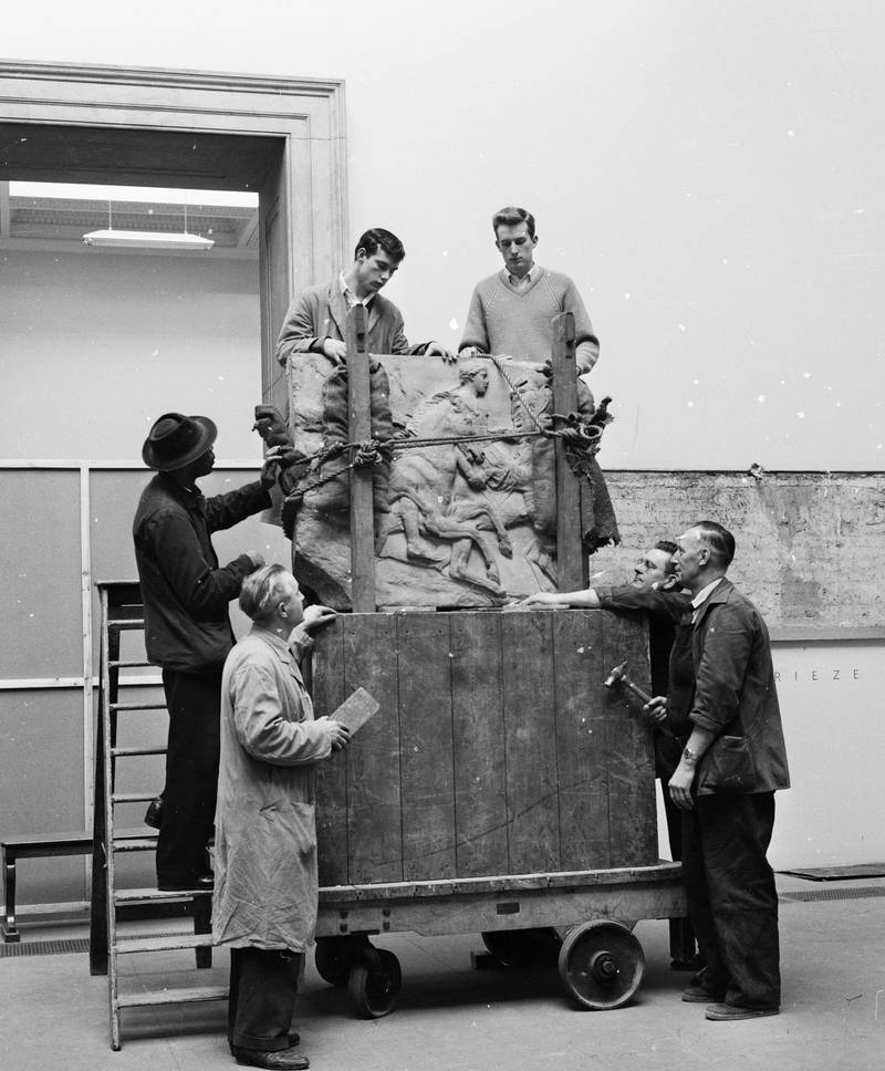 21st December 1961:  Workmen unload a portion of the Parthenon frieze before affixing it to the wall in the new Elgin Marbles room of the British Museum, London.  (Photo by Chris Ware/Keystone Features/Getty Images)