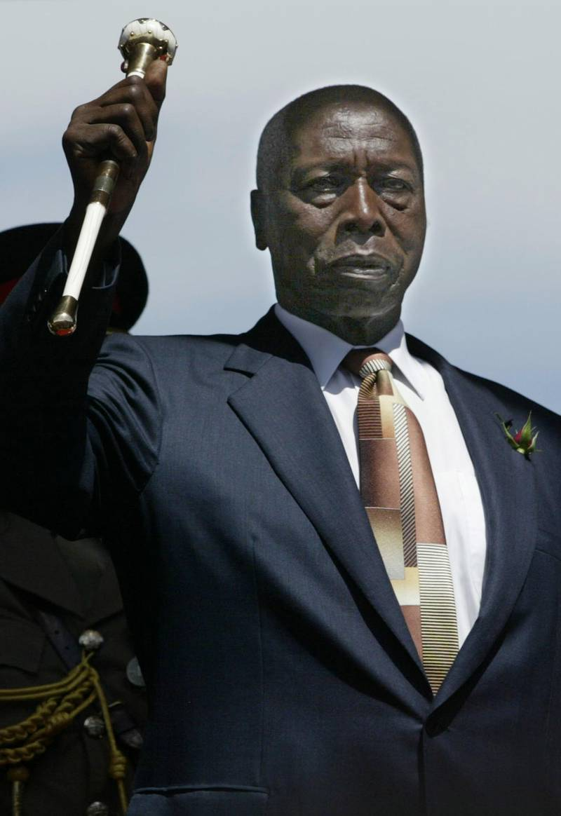 NAIROBI, KENYA - DECEMBER 30:  Outgoing Kenyan President Daniel arap Moi salutes during a swearing-in ceremony for President-elect Mwai Kibaki December 30, 2002 in Nairobi, Kenya. Kibaki, former vice president and finance minister to Moi, representing the opposition National Rainbow Coalition (NARC) vowed to crack down on corruption and poverty. The December 27, 2002 general elections ends Moi's 24-year, autocratic rule.  (Photo by Alessandro Abbonizio/Getty Images)